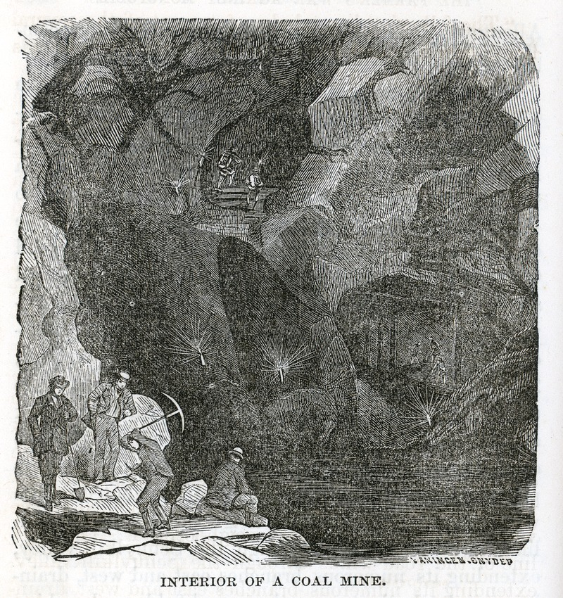 Interior of a coal mine, with workers